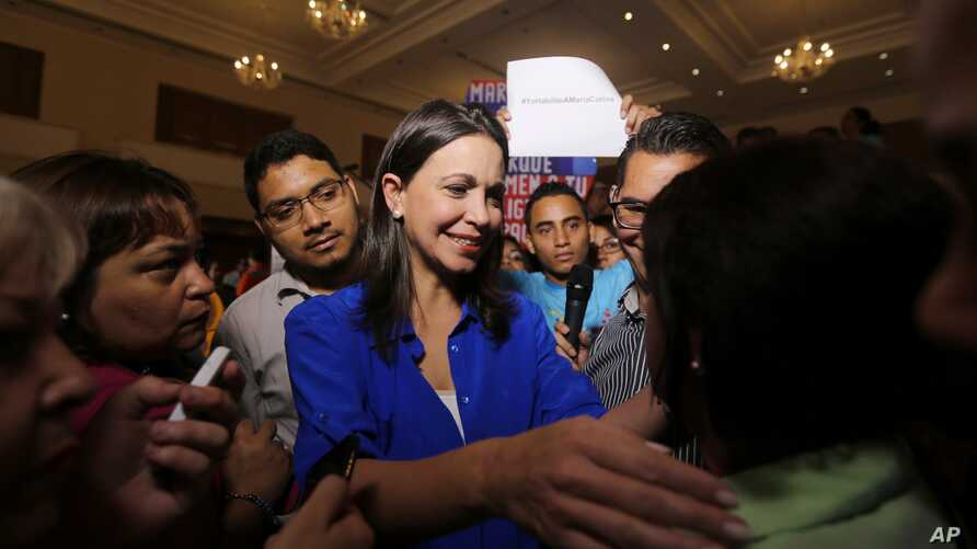 Venezuelan opposition politician Maria Corina Machado, shown greeting supporters after a news conference in Caracas, on July 15, 2015, says she's been barred from holding public office ahead of December's congressional election.