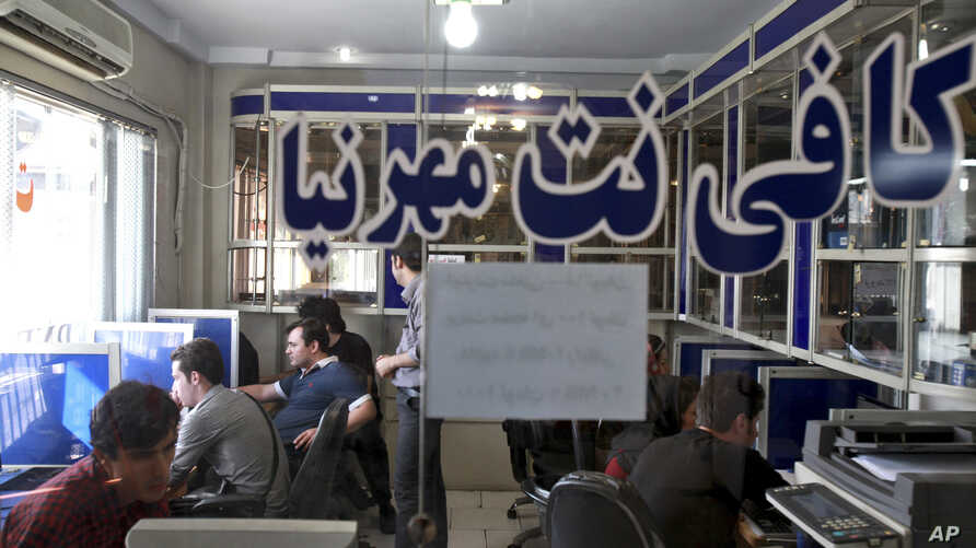 FILE - Iranians surf the Internet at a cafe in Tehran.