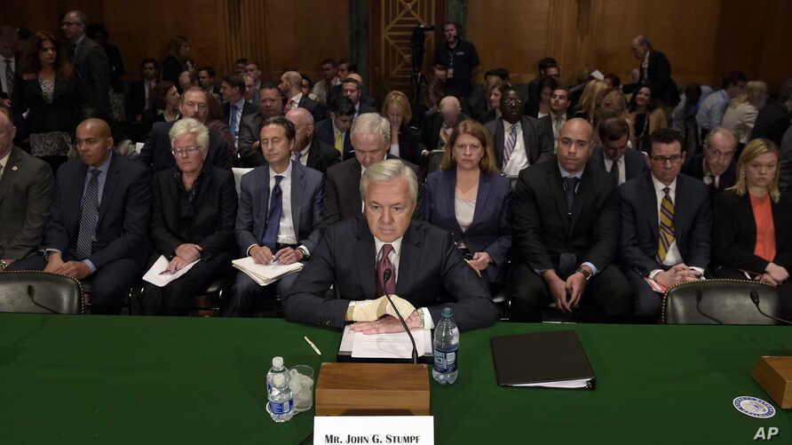 FILE - In this Sept. 20, 2016, photo, Wells Fargo CEO John Stumpf prepares to testify on Capitol Hill in Washington, before the Senate Banking Committee.