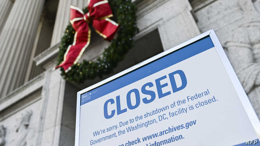 A sign is displayed at the National Archives building that is closed because of a U.S. government shutdown in Washington, Dec. 22, 2018.
