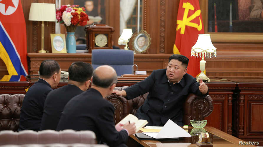 North Korean leader Kim Jong Un meets with the delegation that had visited the United States, in Pyongyang,  in this photo released by North Korea's Korean Central News Agency, Jan. 23, 2019.