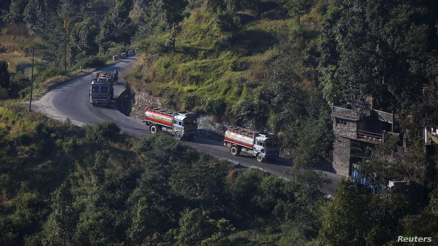 Nepalese petrol tankers heading to the Chinese border of Kerung are pictured on a road on the outskirts of Kathmandu, Nepal, Nov. 2, 2015.