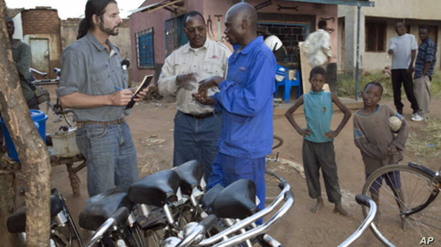 Seen here working with bike mechanics in rural Africa, F.K. Day has given away over 70,000 bikes so far in Zambia and other Sub-Saharan African countries.   .