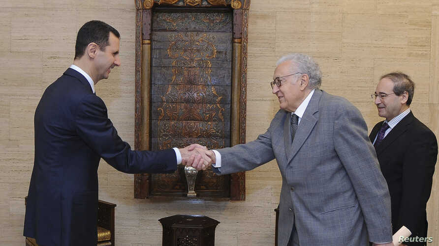 Syria's President Bashar al-Assad (L) shakes hands with U.N.-Arab League peace envoy for Syria Lakhdar Brahimi (C) before a meeting in Damascus October 21, 2012, in this handout photograph released by Syria's national news agency SANA. International