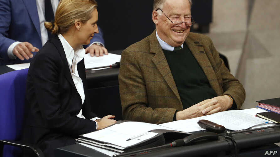 The co-leaders of the Alternative for Germany (AfD) far-right party, Alexander Gauland and Alice Weidel, laugh as they attend a session at the Bundestag lower house of Parliament in Berlin, Nov. 21, 2017.