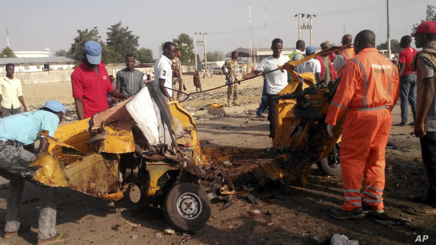 People clear debris after an explosion in Maiduguri, Nigeria, Oct. 29, 2016. Twin explosions from female suicide bombers suspected to be with Boko Haram killed nine people and injured more than 20 in Nigeria's northeastern city of Maiduguri, officia