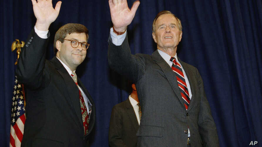 FILE - In this Nov. 26, 1991, photo, President George H.W Bush, right, and William Barr wave after Barr was sworn in as the new attorney general of the United States in Washington. President Donald Trump said Friday he would nominate Barr to serve in