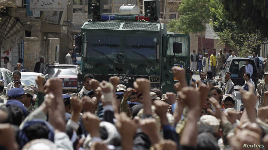 Protesters loyal to the Houthi Shi'ite group are blocked by riot police near the Cabinet's headquarters as they demonstrate to demand for the resignation of the government in Sana'a, Yemen, Sept. 1, 2014.