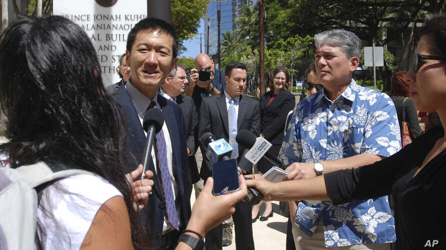Hawaii Attorney General Douglas Chin speaks outside federal court in Honolulu, March 29, 2017.