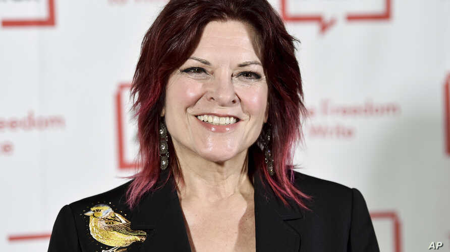 FILE - Rosanne Cash attends the 2018 PEN Literary Gala in New York, May 22, 2018.