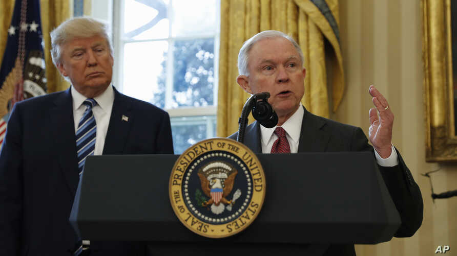 President Donald Trump listens as Attorney General Jeff Sessions speaks in the Oval Office of the White House in Washington, after Vice President Mike Pence administered the oath of office to Sessions.