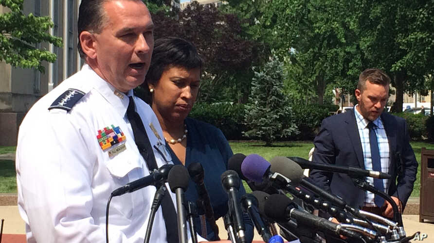 FILE - Washington Police Chief Peter Newsham, accompanied by Mayor Muriel Bowser, speaks to reporters in Washington, May 31, 2017.