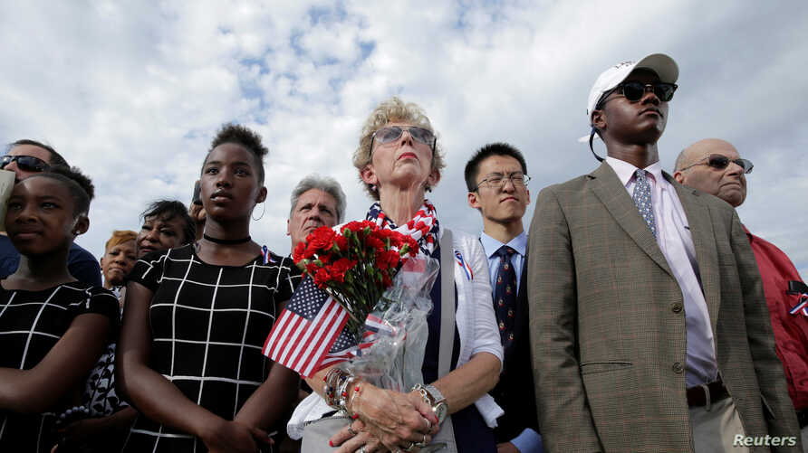People watch as U.S. President Barack Obama, Defense Secretary Ash Carter and Joint Chiefs Chair Gen. Joseph Dunford take part in a ceremony marking the 15th anniversary of the 9/11 attacks at the Pentagon in Washington, U.S., Sept. 11, 2016.
