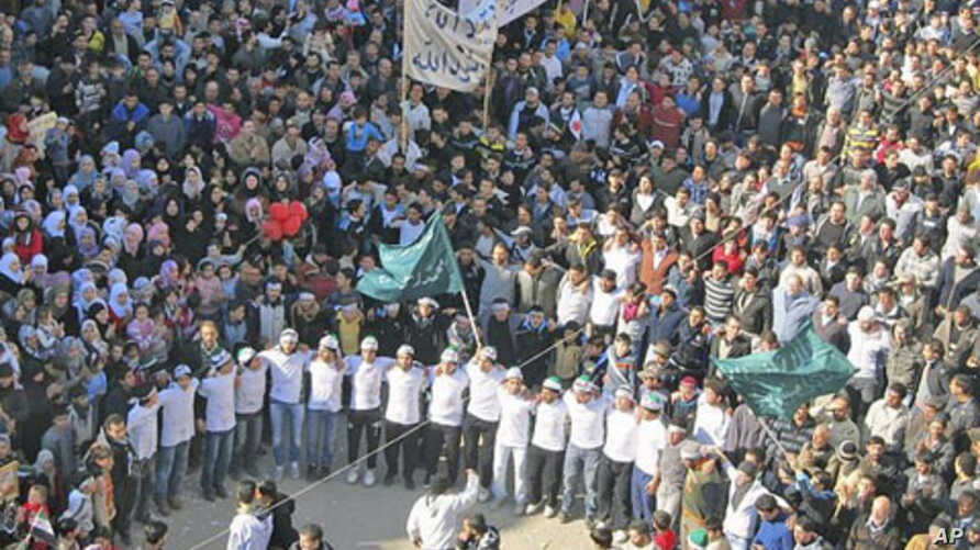 Demonstrators take part in a protest against Syria's President Bashar al-Assad after Friday prayers in Baba Amro, near Homs, February 3, 2012.