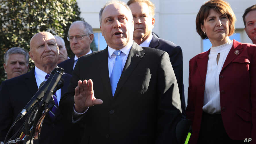 Rep. Rep. Steve Scalise, R-La., center, together with Rep. Kevin Brady, R-Texas, left, and Rep. Cathy McMorris Rodgers, R-Wa., right, and other Republican members of Congress speaks to reporters outside the West Wing of the White House following a me