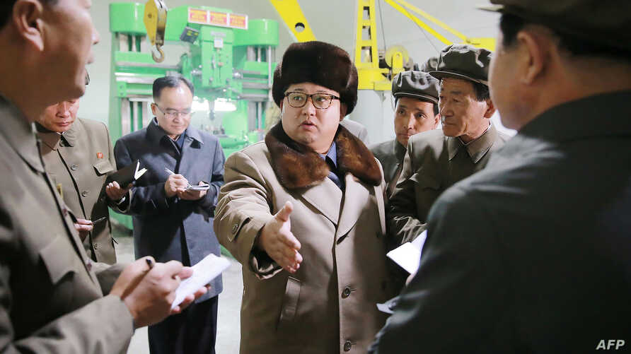 This undated photo released by North Korea's official Korean Central News Agency (KCNA) on April 1, 2016 shows North Korean leader Kim Jong-Un (C) visting the Sinhung Machine Plant in South Hamgyong Province.