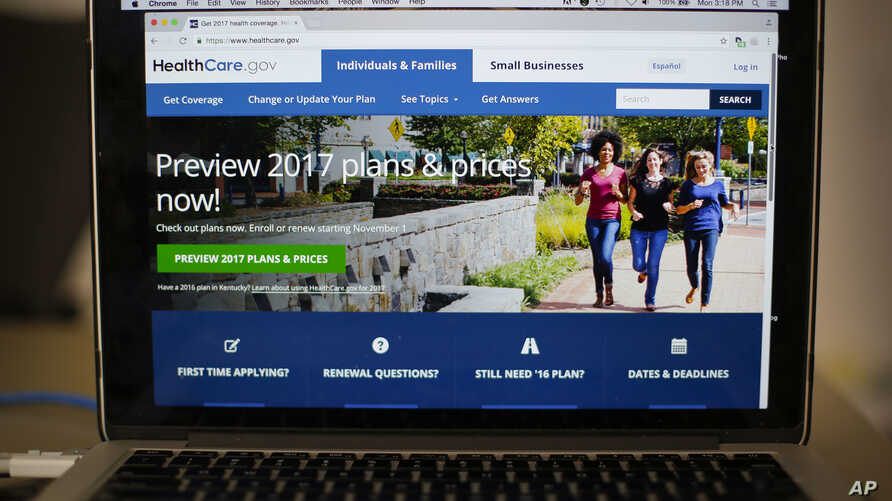 FILE - The HealthCare.gov 2017 home page is seen on a laptop in Washington.