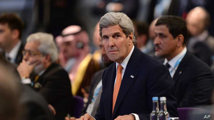 "FILE - U.S. Secretary of State John Kerry attends the ""Supporting Syria and the Region"" conference in London, Feb. 4, 2016. Kerry said Sunday the ""path to peace"" in Syria is ""actually right in front of us now."""