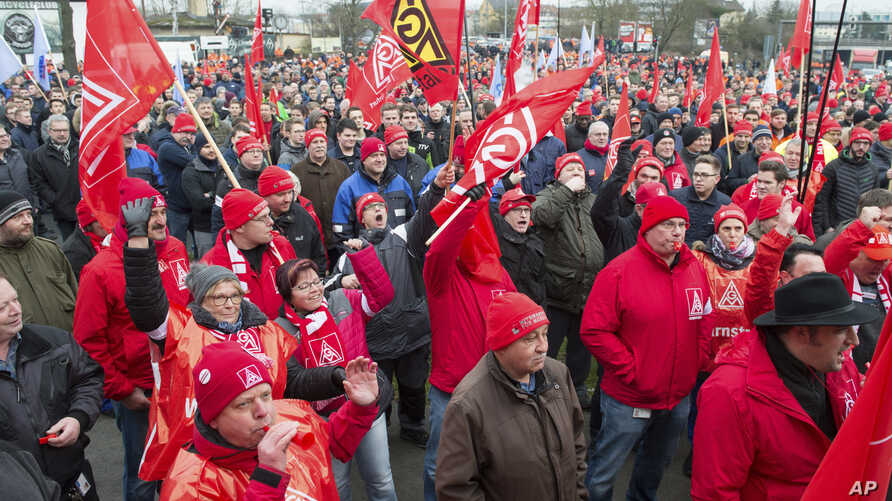 Metalworkers demonstrate in Schweinfurt, southern Germany, Tuesday, Jan. 9, 2018. Germany's largest industrial union pressed its demands for pay rises and the possibility for reduced work hours for its 3.9 million members with renewed short-term stri