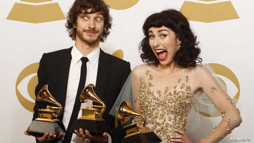 Gotye poses with his Grammy awards for Best Pop Duo/Group Performance with Kimbra (R) and for Best Alternative Music Album, backstage at the 55th annual Grammy Awards in Los Angeles, California Feb. 10, 2013.
