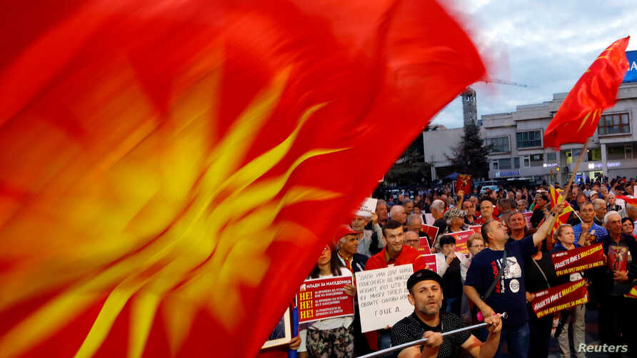 Protesters shout slogans against the change of the country's constitutional name in front of the Parliament building in Skopje, Macedonia, June 23, 2018.