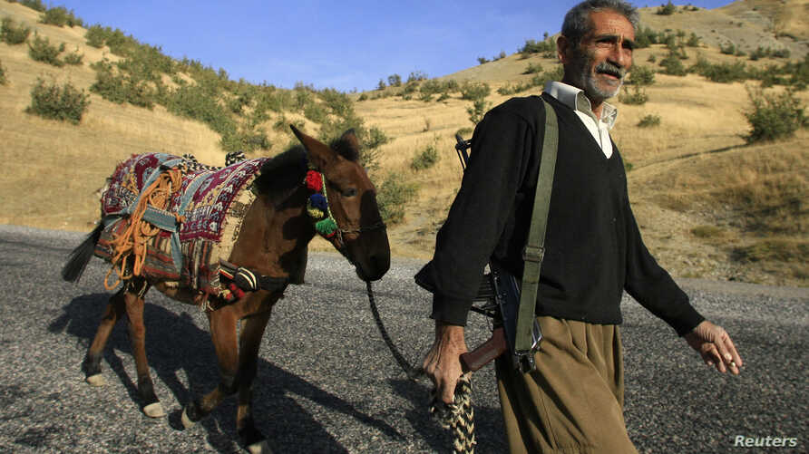 A Kurdish village guard patrols a road in the southeastern Turkish province of Sirnak in this Oct. 23, 2007 file photo.