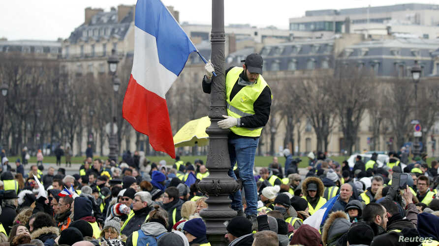Protesters wearing yellow vests take part in a demonstration in Paris, Jan. 19, 2019.