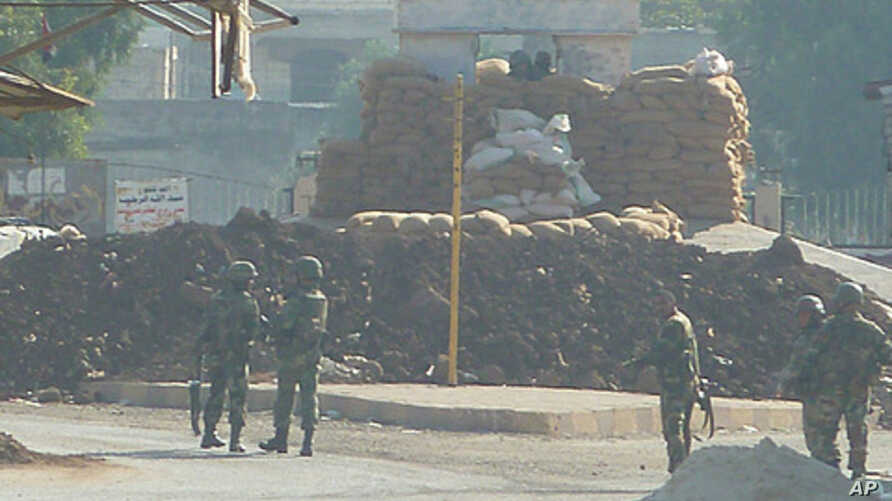 Soldiers are seen at an army checkpoint in Hula, near Homs, Syria, November 4, 2011.