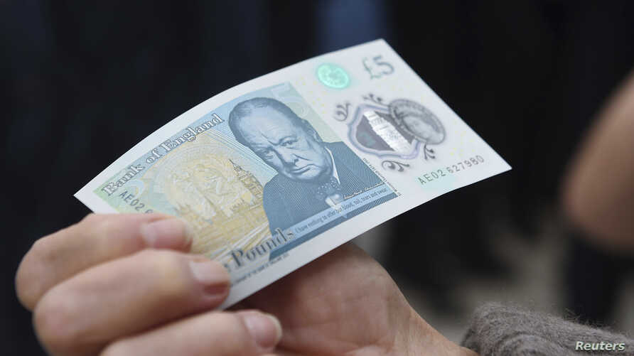 The new polymer 5 pound Sterling note featuring Sir Winston Churchill, is unveiled at Blenheim Palace in Oxfordshire, Britain June 2, 2016.