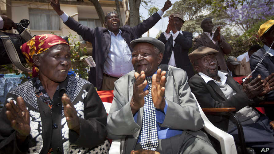 Seated left to right, Kenyans Jane Muthoni Mara, Wambogo Nyingi and Paulo Muoka Nzili celebrate the announcement of a legal decision in support of Mau Mau veteran reparation payments in Nairobi in this October 5, 2012, file photo.