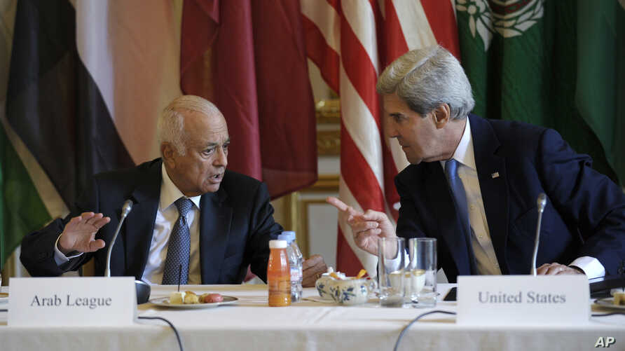 U.S. Secretary of State John Kerry talks with Arab League Secretary General Nabil Elaraby before the start of a meeting with representatives of the Arab League at the United States Embassy in Paris, Sunday, Sept. 8, 2013.