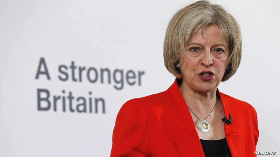 Britain's HomaBritain's Home Secretary Theresa May speaks at a news conference in London, March 23, 2015.