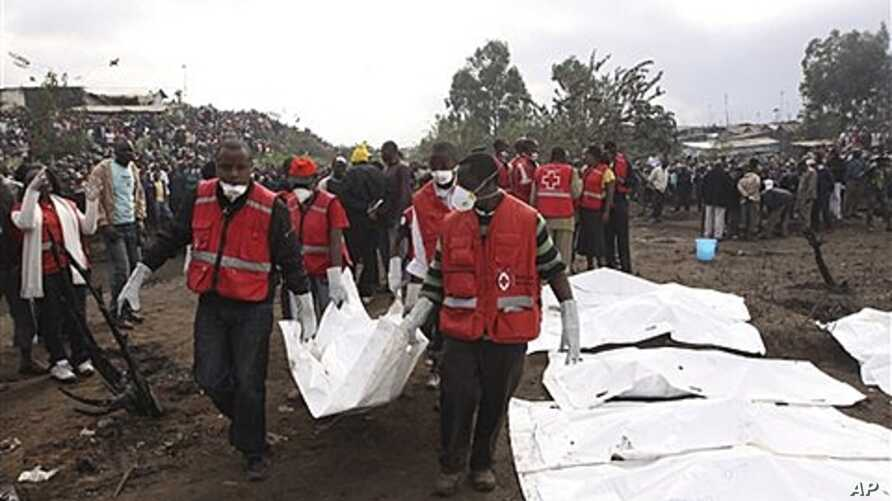 Red Cross workers collect bodies after a pipeline explosion on Monday, Sept. 12, 2011.