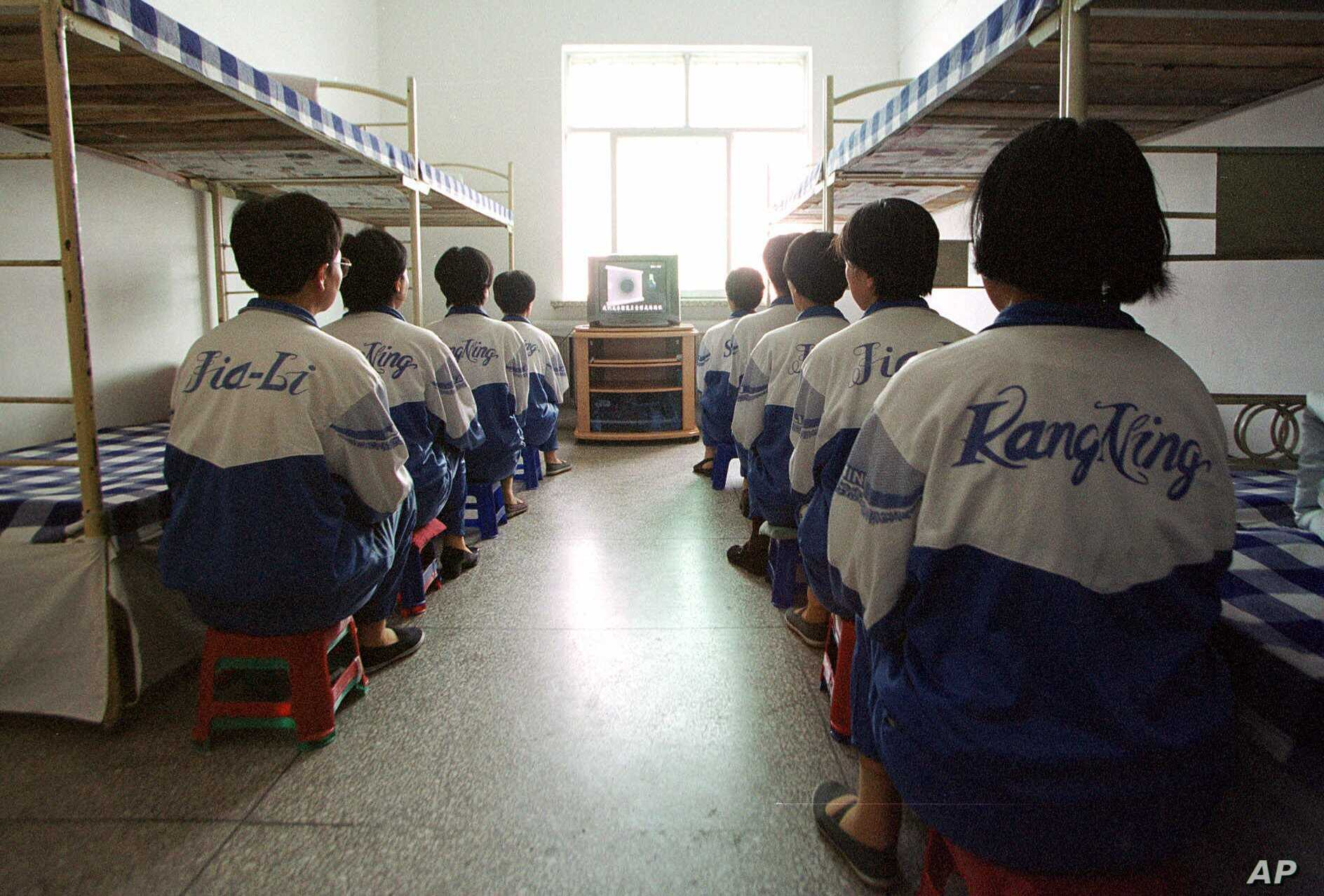 Falun Gong practitioners watch a video about a solar eclipse, part of deprogramming efforts enforced at the Masanjia Reeducation-through-labor camp in northeast China's Liaoning province. (file photo)