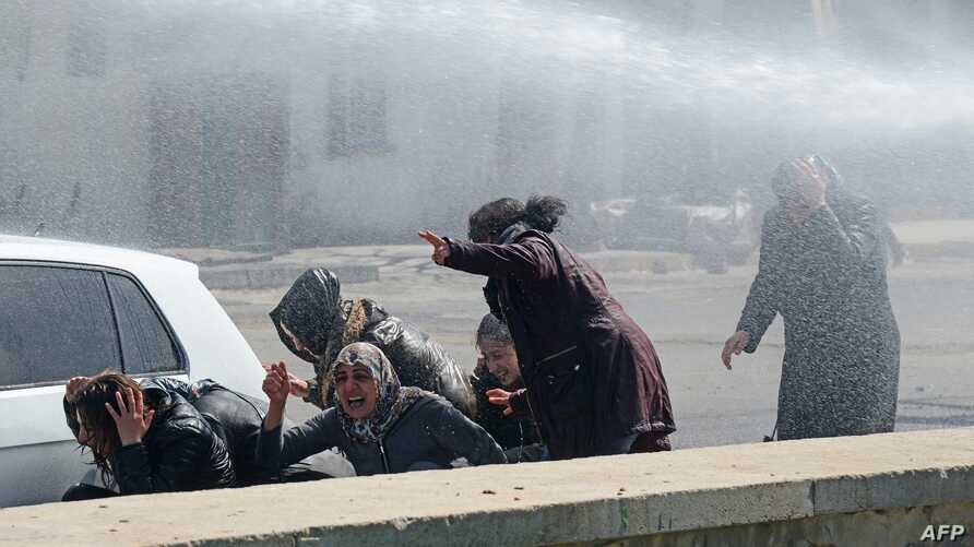 FILE - Turkish riot police use a water canon to disperse protesters during Kurdish activist Zulkuf Gezen's funeral in the Turkish city of Diyarbakir, March 18, 2019.