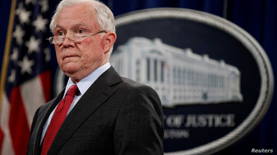 "U.S. Attorney General Jeff Sessions stands during a news conference to discuss ""efforts to reduce violent crime"" at the Department of Justice in Washington, Dec. 15, 2017."