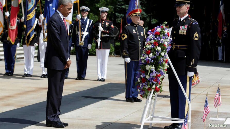 U.S. President Barack Obama lays a wreath at the Tomb of the Unknown Soldier during the Memorial Day observance at Arlington National Cemetery in Washington, U.S., May 30, 2016.