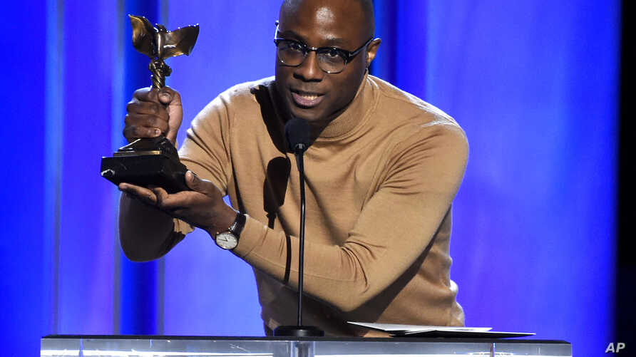 """Barry Jenkins accepts the award for best director for """"If Beale Street Could Talk"""" at the 34th Film Independent Spirit Awards, Feb. 23, 2019, in Santa Monica, Calif."""