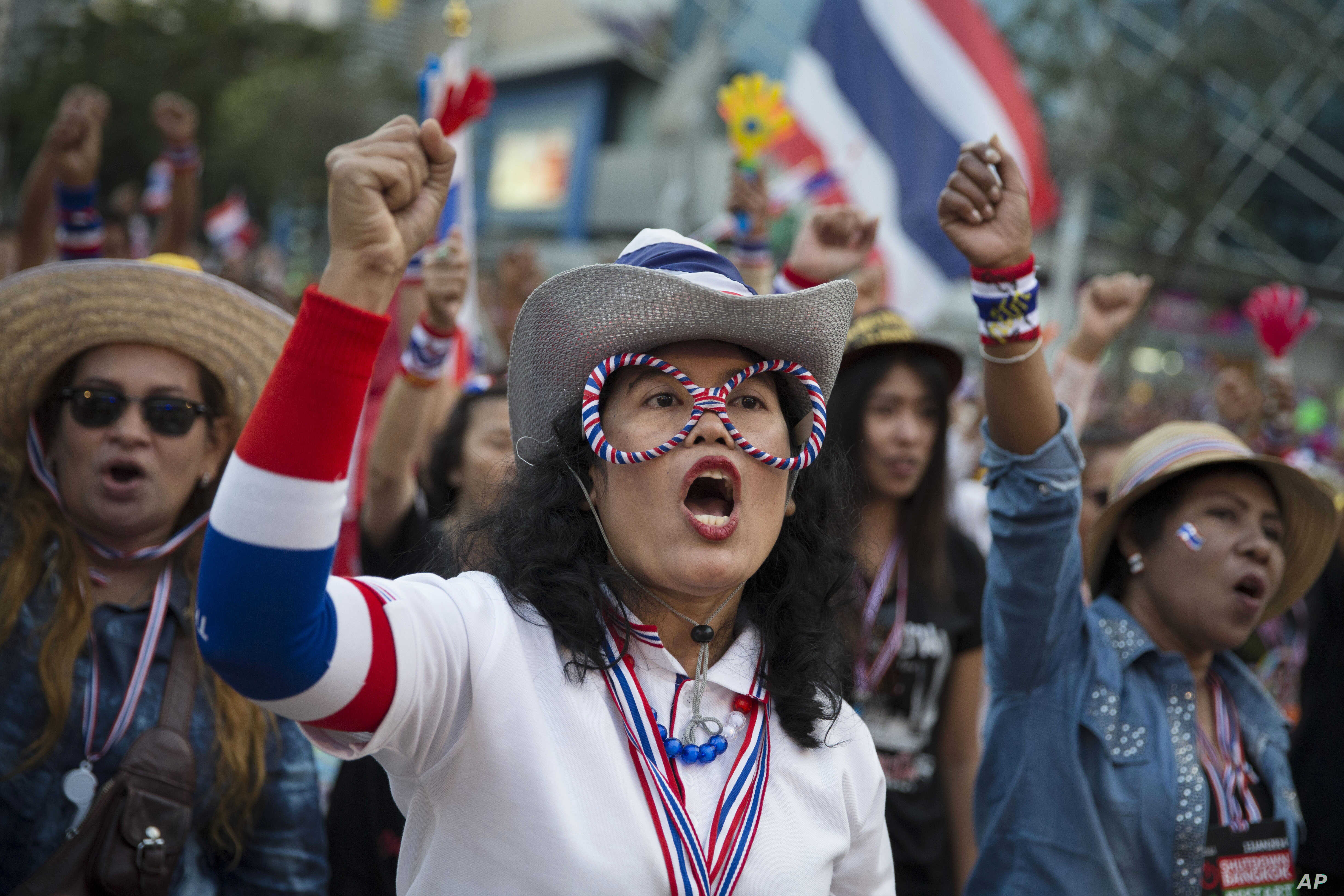 Anti-government People's Democratic Reform Committee protesters cheer at an encampment in the Pathumwan district in Bangkok, Jan. 16, 2014.