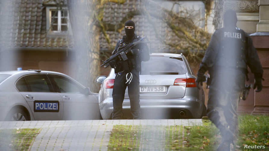 Members of the German special police force SEK are seen standing guard outside a building in Karlsruhe, Germany, Dec. 15, 2015.