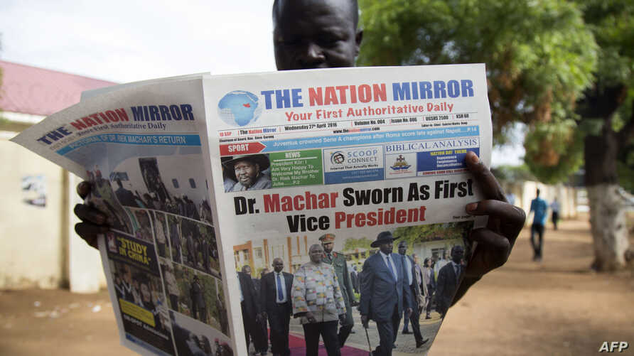 A resident reads a daily newspaper in Juba, South Sudan,  April 27, 2016