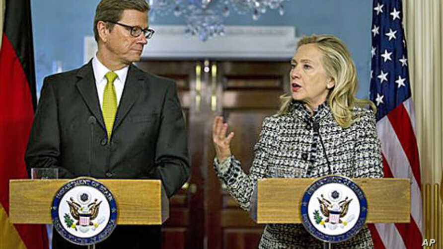 Secretary of State Hillary Rodham Clinton gestures during a news conference with German Foreign Minister Guido Westerwelle, at the State Department in Washington, January 20, 2012.