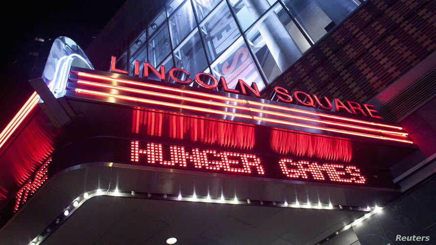 """FILE - A marquee advertising """"The Hunger Games""""  is seen at the AMC Loews Lincoln Square Theatre in New York, March 22, 2012."""