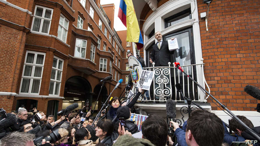 WikiLeaks founder Julian Assange (C) addresses media and supporters from the balcony of Ecuador's embassy in central London, Feb. 5, 2016.