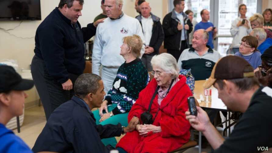 President Barack Obama and New Jersey Gov. Chris Christie talk with local residents at the Brigantine Beach Community Center in Brigantine, New Jersey, October 31, 2012.