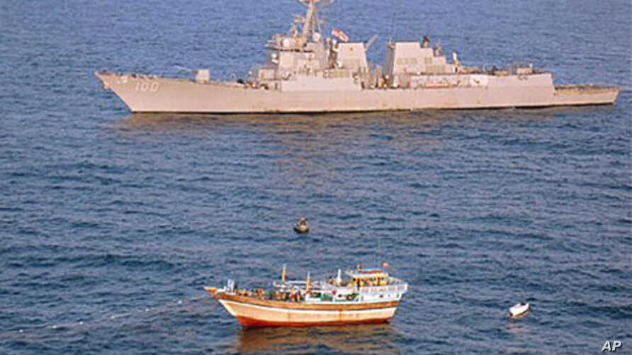The guided-missile destroyer USS Kidd responds to a distress call from the Iranian-flagged fishing vessel Al Molai, which was being held captive by pirates in the Arabian Sea, January 5, 2012.