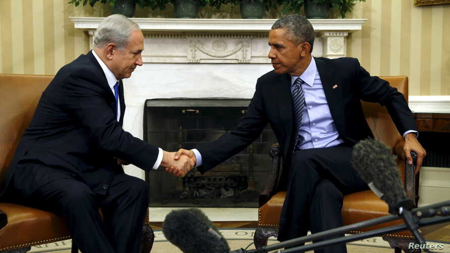 U.S. President Barack Obama and Israeli Prime Minister Benjamin Netanyahu shake hands during their meeting in the Oval Office of the White House in Washington, Nov. 9, 2015.