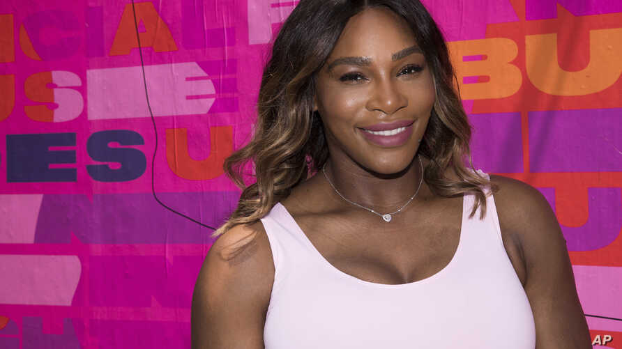Professional tennis player Serena Williams appears at an event to launch a national street art campaign with Allstate Foundation Purple Purse to make domestic violence and financial abuse visible, at TicTail Market on June 20, 2018, in New York.