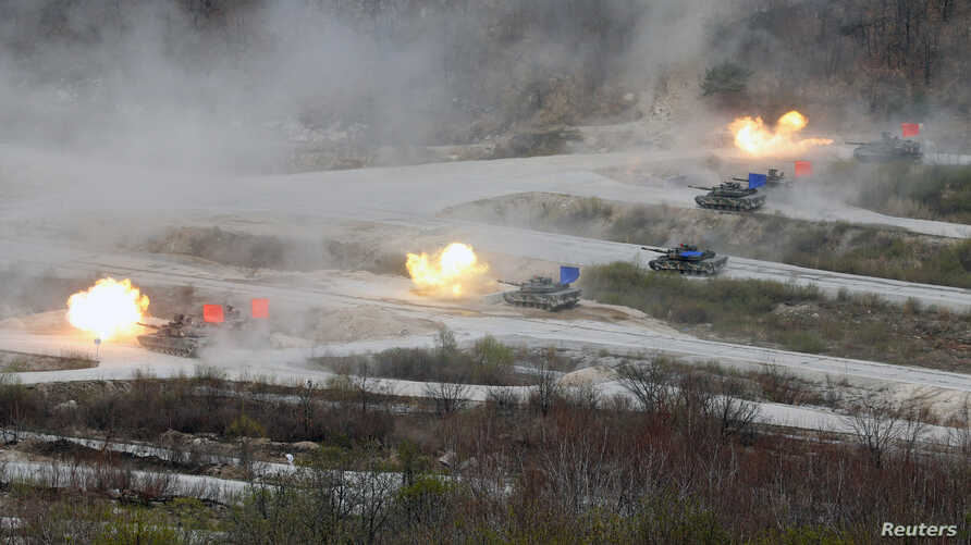South Korean Army K1A1 and U.S. Army M1A2 tanks fire live rounds during a U.S.-South Korea joint live-fire military exercise, at a training field near the demilitarized zone separating the two Koreas in Pocheon, South Korea, April 21, 2017.