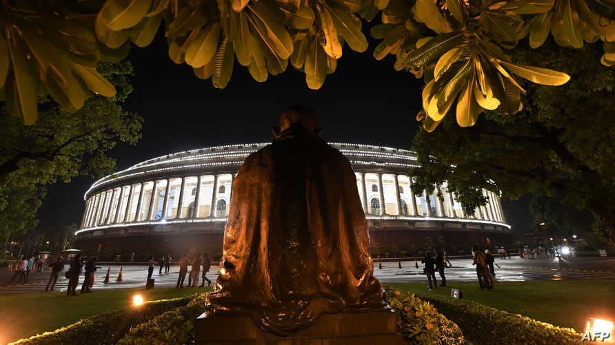 View of the Indian Parliament illuminated prior to a special session for the implementation of the new Goods and Services Tax (GST) regime in New Delhi, June 30, 2017.